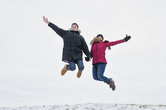 Two teenagers havinf fun on the snow field royalty free stock photos