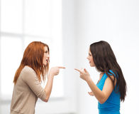 Two teenagers having a fight Stock Images