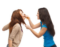 Two teenagers having a fight and getting physical. Bullying, friendship and people concept - two teenagers having a fight and getting physical Royalty Free Stock Photos
