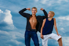 Two teenagers having fun on the beach. The sky in the background Royalty Free Stock Photo