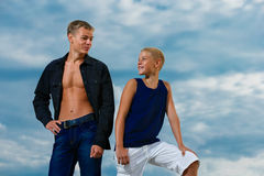 Two teenagers having fun on the beach. The sky in the background Royalty Free Stock Image