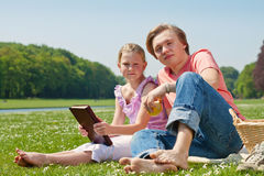 Two teenagers having picnic Stock Images