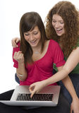Two teenagers with laptop computer Royalty Free Stock Images