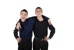 Two teenagers laughing embracing Stock Photos