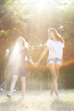 Two teenagers laughing at the park. Beautiful teens having fun in nature Royalty Free Stock Image
