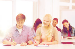 Two teenagers with notebooks at school Stock Photography