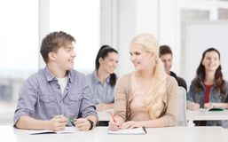 Two teenagers with notebooks at school Royalty Free Stock Photo