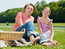 Two teenagers at picnic Stock Images