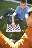 Two teenagers playing chess. Stock Photo