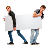 Two teenagers pulling blank billboard Royalty Free Stock Photography
