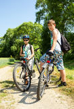 Two teenagers relaxing on a bike trip Royalty Free Stock Images