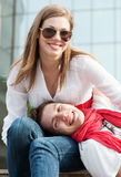 Two teenagers resting at the street Stock Photo