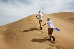 Two teenagers rise to the Dunes Stock Photo