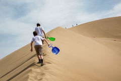 Two teenagers on sand dunes Royalty Free Stock Photo