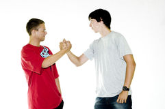 Two Teenagers Shaking Hands Stock Photography