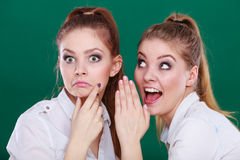 Two teenagers shares secrets, gossip Stock Images