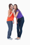 Two teenagers singing in a microphone Royalty Free Stock Photography