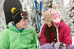 Two Teenagers On Ski Holiday In Mountains. With Snowboard And Skis Royalty Free Stock Photography
