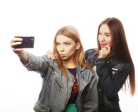 Two teenagers taking picture with smartphone Royalty Free Stock Photos