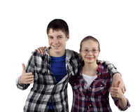 Two teenagers. Teenage relationship and friendship - Boy and girl in plaid shirts stand in embrace with happy smiles isolated on white background Stock Photos