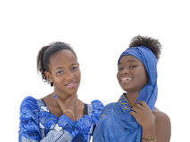 Two teenagers wearing blue celebration dresses, isolated Stock Images
