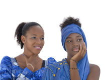 Two teenagers wearing blue celebration dresses, isolated Royalty Free Stock Photos