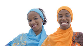 Two teenagers wearing embroidered dresses and headscarves, isolated Royalty Free Stock Photos