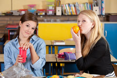 Two teens in classroom Royalty Free Stock Photo