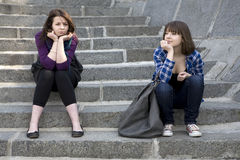 Two teens girl sitting on stairs Royalty Free Stock Image