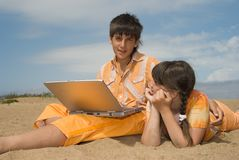 Two teens  with laptops Stock Image