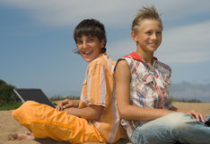 Two teens  with laptops Stock Photo