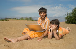 Two teens  with laptops Royalty Free Stock Image