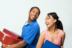 Two Teens Stand Back to Back - Horizontal Royalty Free Stock Images