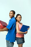 Two Teens Stand Back To Back - Vertical Royalty Free Stock Image