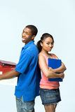Two Teens Stand Back to Back - Vertical Royalty Free Stock Photography