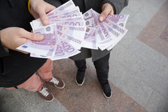 Two Teens Staying With Funs Of Euro In Hands Stock Photos