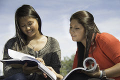 Two teens or young women studying Stock Photos