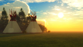 Two Teepees at Sunset Royalty Free Stock Image