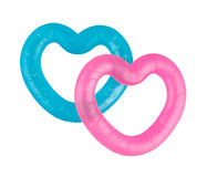 Two teethers blue and pink colors. Two heart-shaped teethers blue and pink colors isolated on white background Royalty Free Stock Images