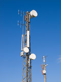 Two telecommunications antennas. On blue sky royalty free stock photos