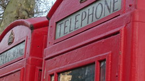 Two telephone booths from the streets of London stock footage