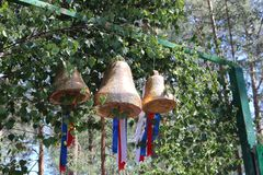 Two temple bells made of brass hanging through chain against cloudy sky. Himachal Pradesh stock images