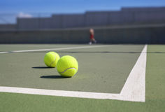 Two tennis ball near baseline Stock Images