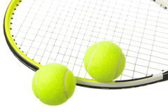 Two tennis balls and racket Stock Images