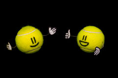 Two tennis balls talking Royalty Free Stock Photo
