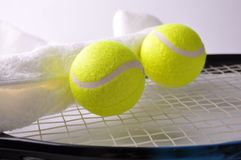 Two tennis balls and white towel Royalty Free Stock Photography