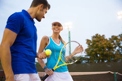 Two tennis player talking outdoors Stock Photos