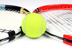 Two tennis racket and ball Stock Photos
