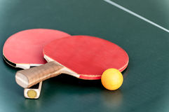 Two tennis racket and a ball Stock Photos