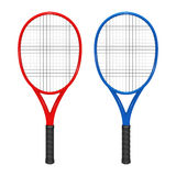 Two tennis rackets - red and blue Royalty Free Stock Image